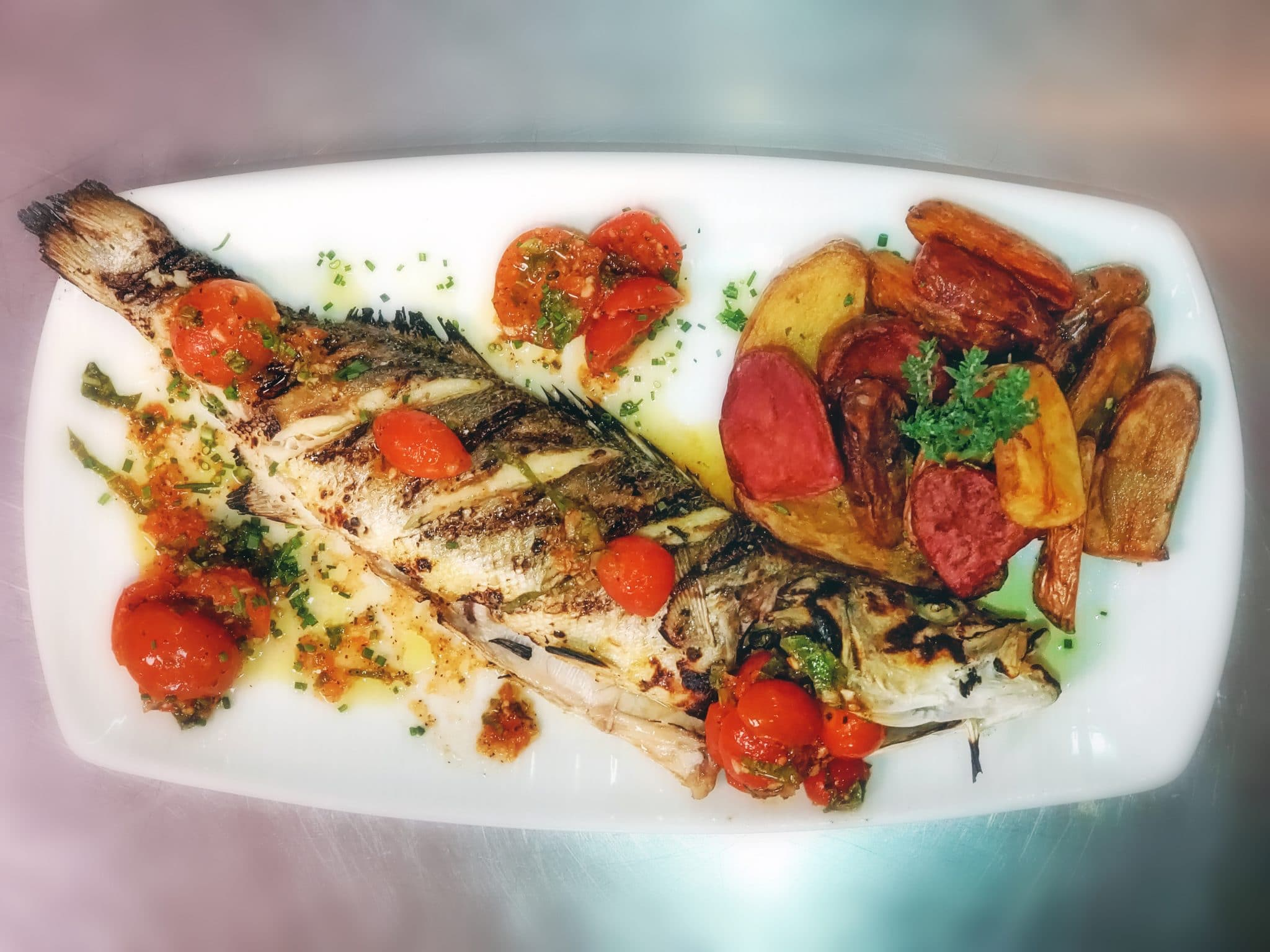 Roasted Whole European Seabass with Potatoes and Marinated Cherry Tomato Salad