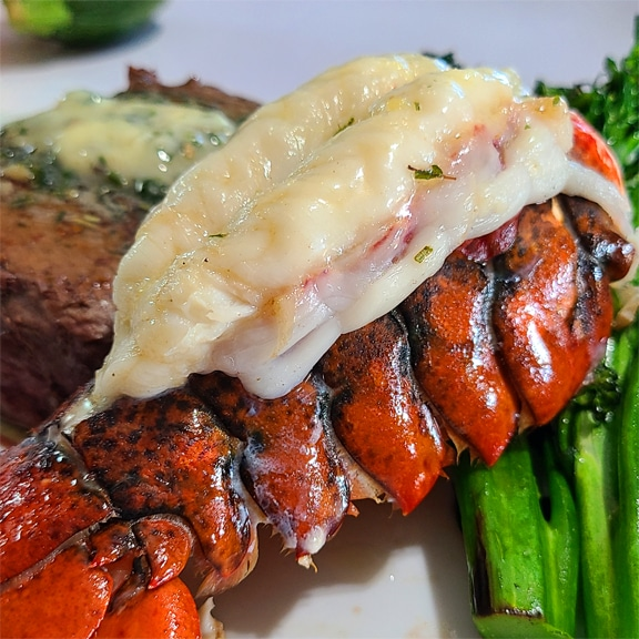 cooked lobster tail with garlic and herb butter